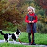 Little girl in a jumper and her four-legged friend