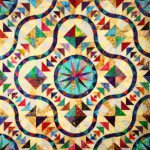 A beautiful quilt with a stained glass design.
