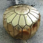 Add some glitz with this gold leather pouf from Table Tonic