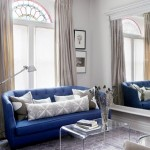 This cobalt blue sofa really pops against all the white walls.  Courtesy of flourish and design