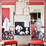 This red and black room designed by Tobi Fairley utilizes a lighter shade of red anchored by black and brightened up with white.