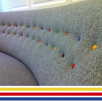 This sofa has been tufted with multi colored buttons for a playful look (photo courtesy of brightbazaar)