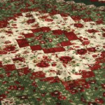 A quilt  in the Around the World Pattern made in cotton Christmas prints.