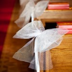 Netting bows are an elegant, but very inexpensive decoration for church pews.