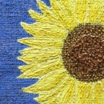 Cheerful sunflower painted on burlap.