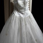 Hanging a wedding dress for a prolonged period of time can cause the fabric to stretch and distort.
