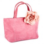 This pink faux leather tote has simple lines and can be made with ease by a person with intermediate sewing skills.