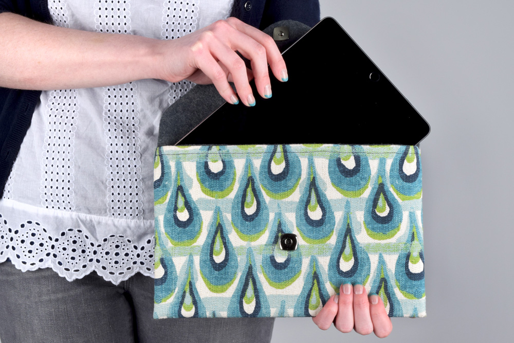 ... use it as a tablet case or a clutch, it's both stylish and practical