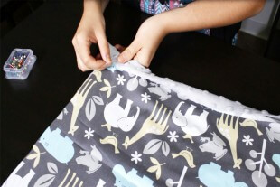How to Sew an Easy Baby Blanket - Pinning the fabric