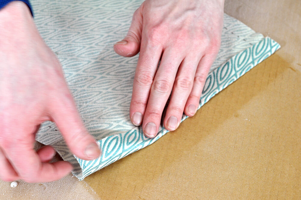How to Cover a Lampshade with Fabric - Step 3: Coat the fabric with spray adhesive