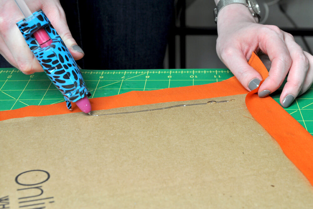 DIY Fabric Storage Bin - Step 3: Glue fabric to bottom cardboard