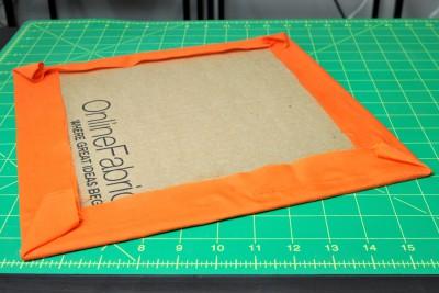 DIY Fabric Storage Bin - Step 3: Glue fabric to bottom cardboard