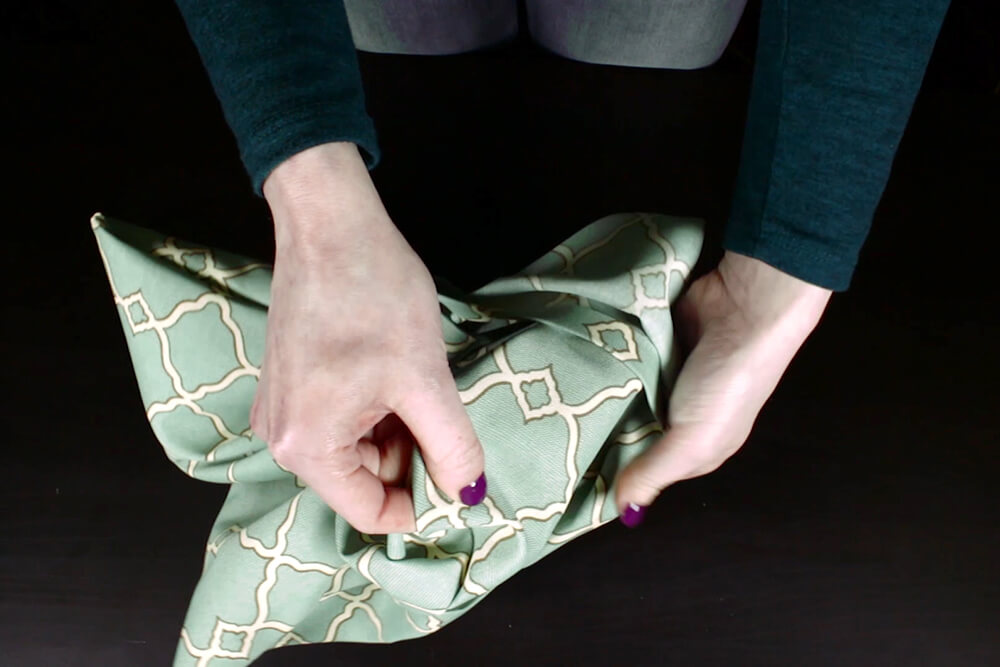 No Sew Outdoor Pillow DIY Tutorial - Turning the cover right side out
