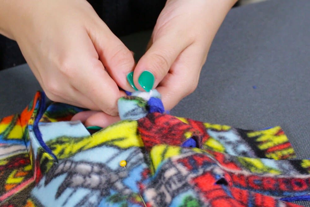 How to make a no sew fleece pillow - Tie the knots and insert the pillow form