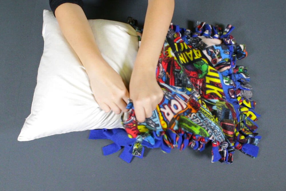 How to make a no sew fleece pillow - tTie the knots and insert the pillow