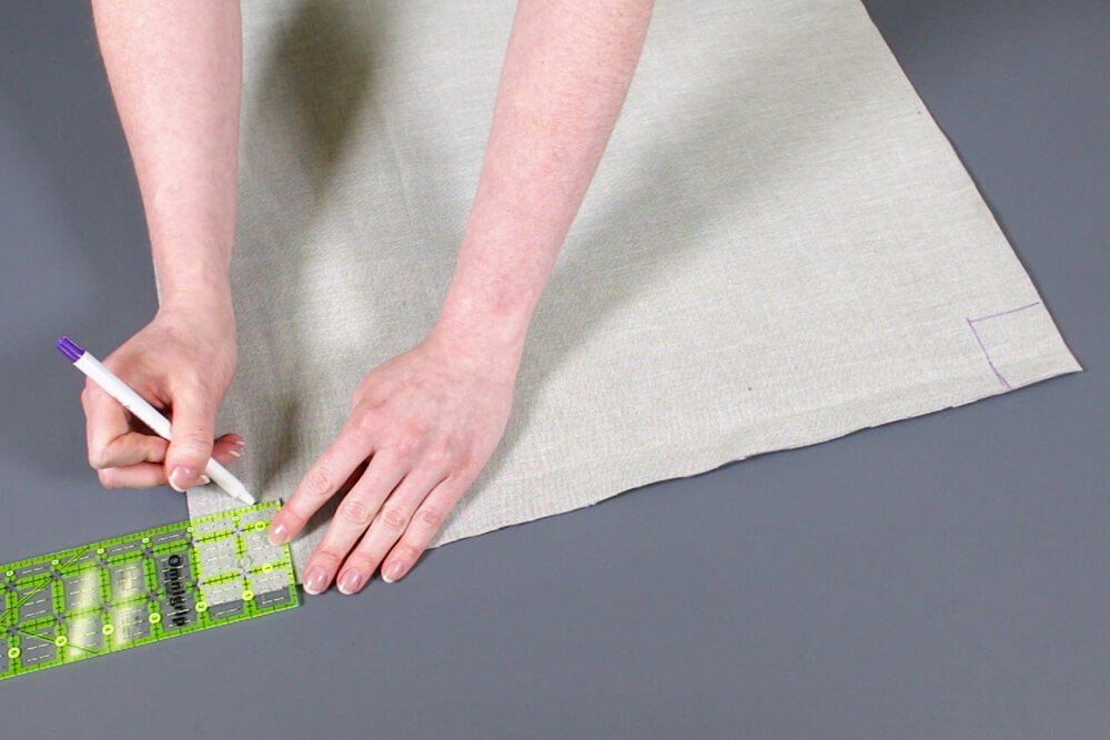 How to Make a Pouf Ottoman - Sew the corners on the top and bottom