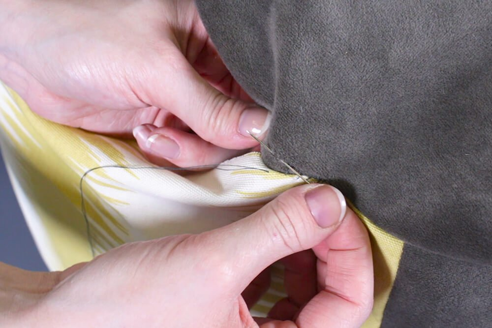 How to Make a Pouf Ottoman - Hand sew the pouf closed