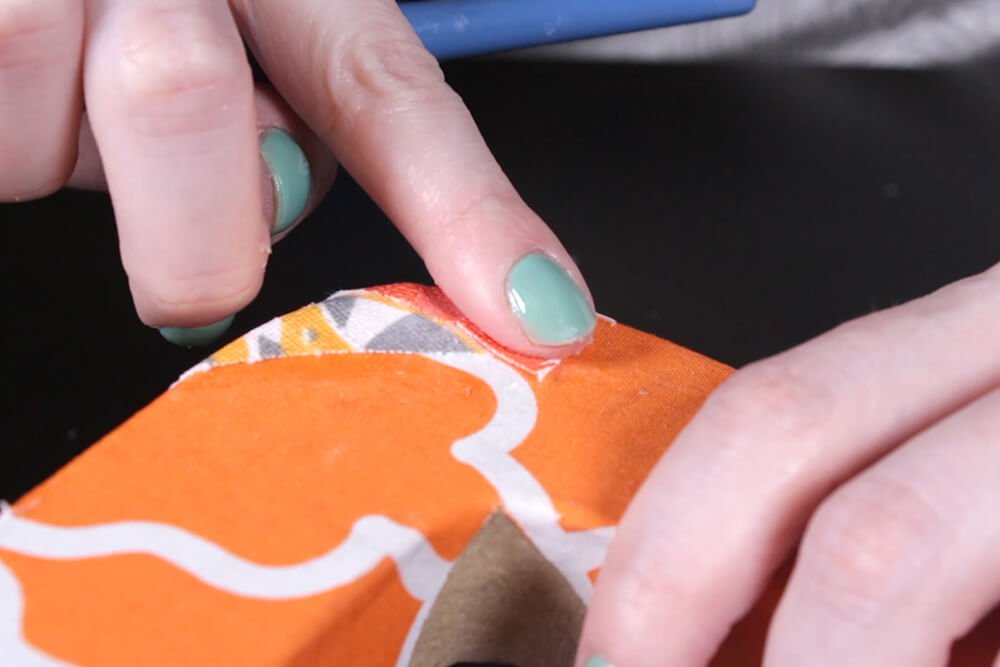 How to Decoupage with Fabric - Glue on the fabric
