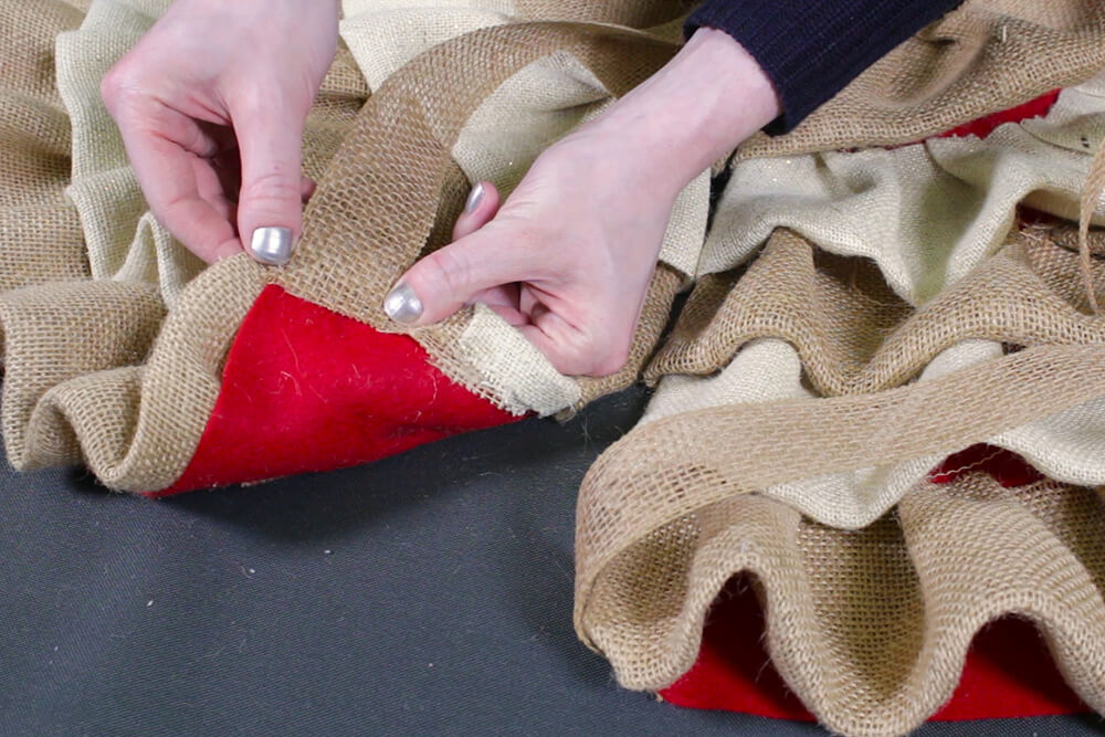 Burlap Tree Skirt - Continue glueing the ribbon to the top, middle, and bottom