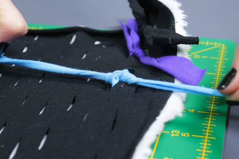 How to Make a Shag Rug - Cut and tie the strips