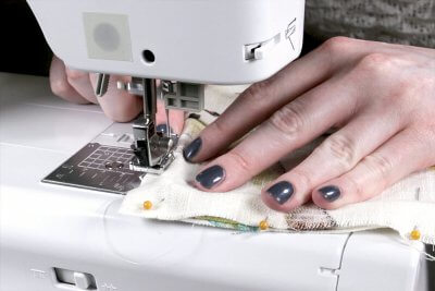 How to Make & Sew Piping - Sew close to the piping with the zipper foot for a tight fit
