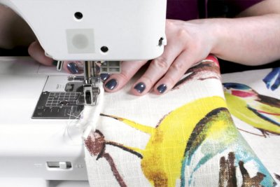 How to Make & Sew Piping - Match up the edges of the fabric and the piping and sew