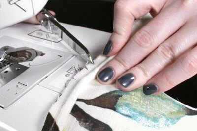 How to Make & Sew Piping - Make a couple of cuts into the edge of the piping at corners