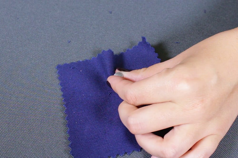 How To Attach a Jeans Button - Flip the fabric and hammer it down