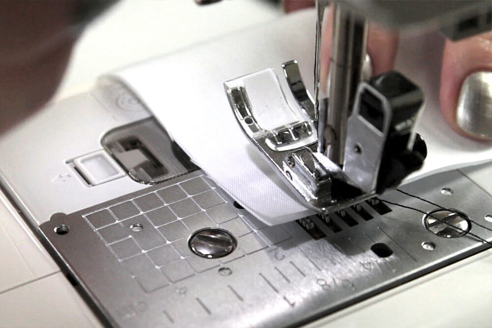 Sewing Machine Basics - Place fabric under presser foot