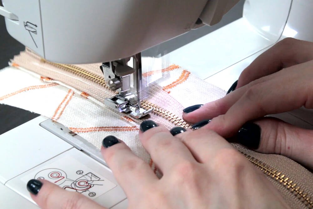 How to Sew an Upholstery Zipper -Sew one side with the zipper foot on
