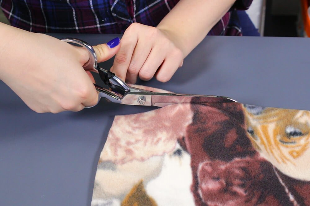 How to Make a No Sew Fleece Dog Bed - Cut and tie the knots