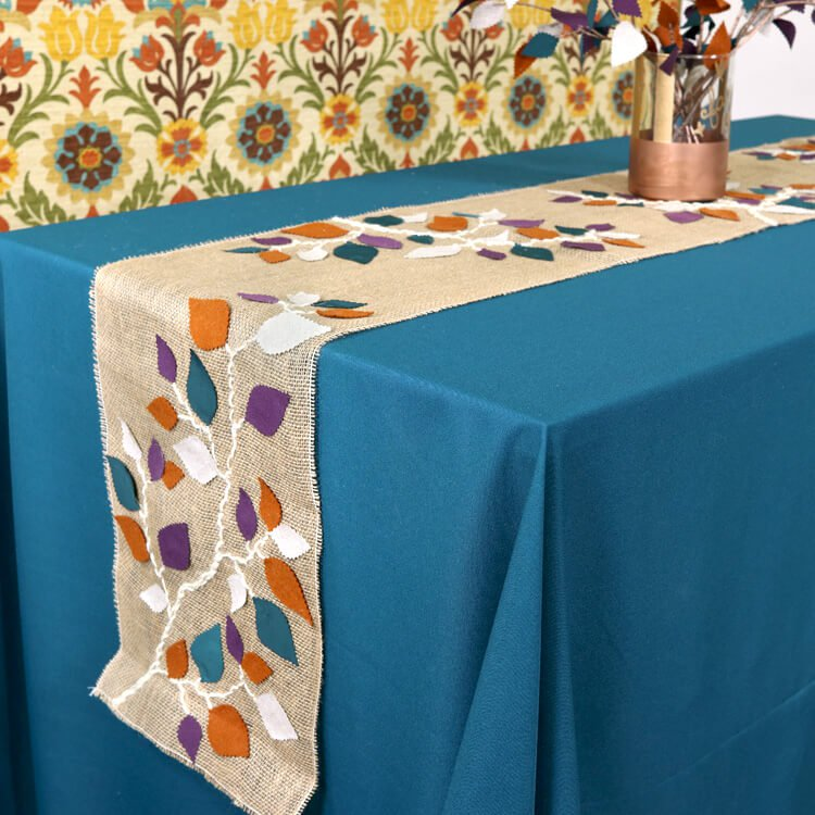 Decorating a Burlap Table Runner with Leaves