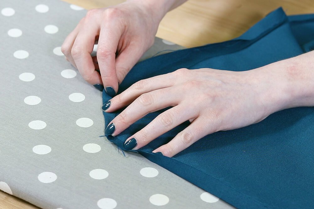 How to Make a Tablecloth - Fold diagonal edge in
