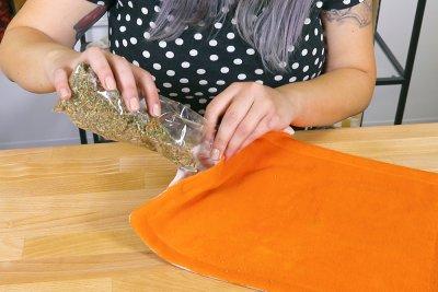 How To Make a Catnip Blanket - Step 6 - Topstitch around the corners and add catnip