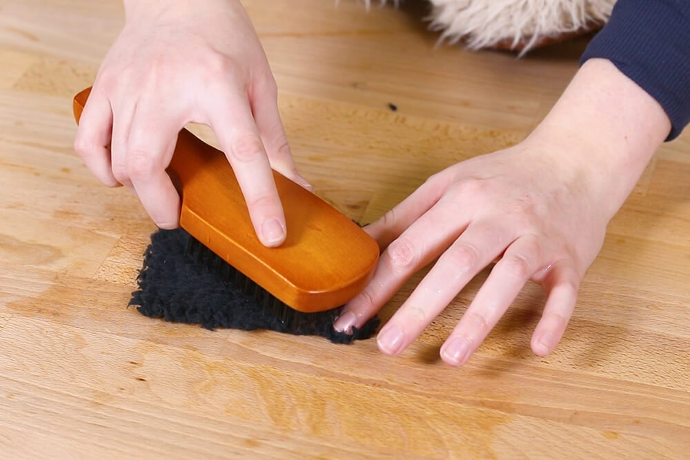 Brush out matted areas with boars hair brush