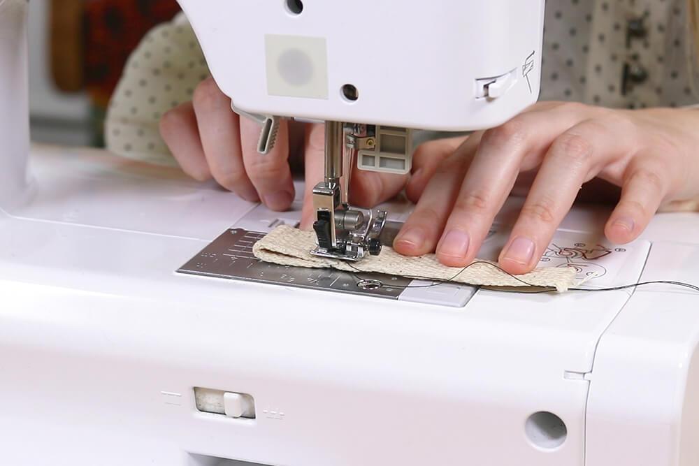 Finishing webbing using a sewing machine