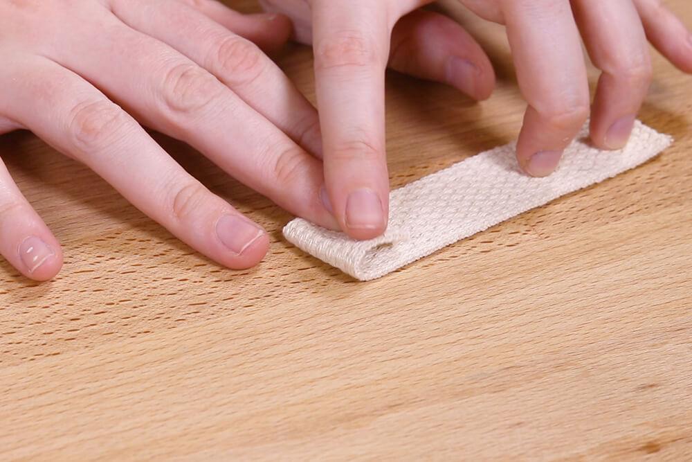 Prepare webbing by folding