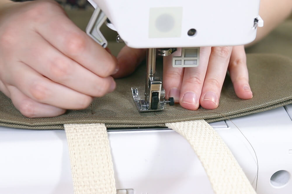 "Sew a square with an ""X"" through the webbing"