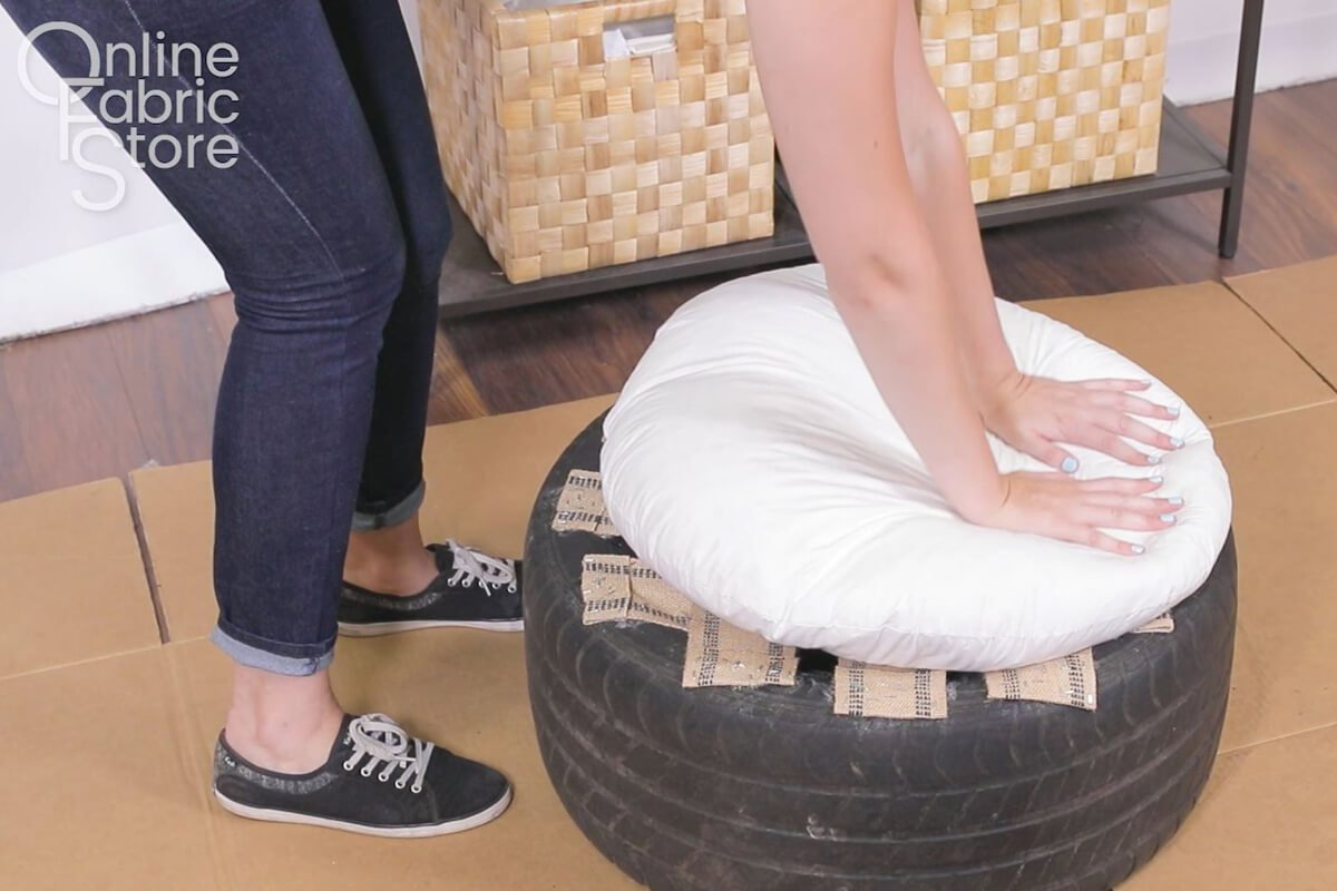 Attach a pillow to the seat of the tire