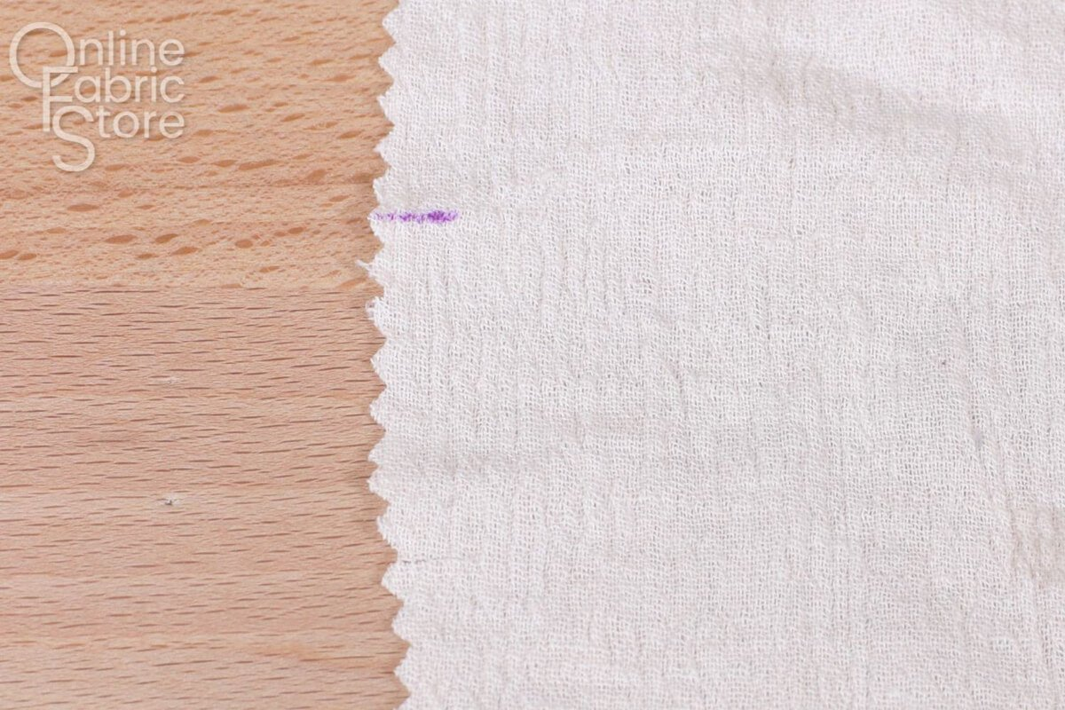 Marking notches in fabric