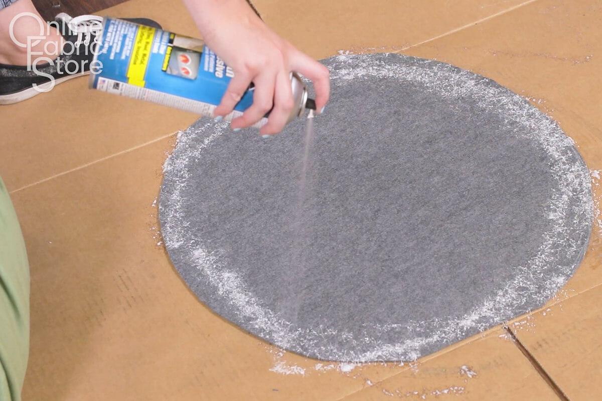 Spray adhesive around the felt