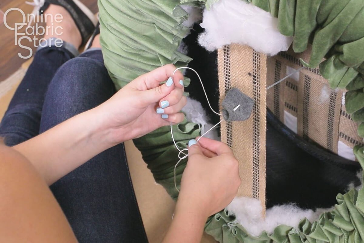 Tie the button down using a slip knot