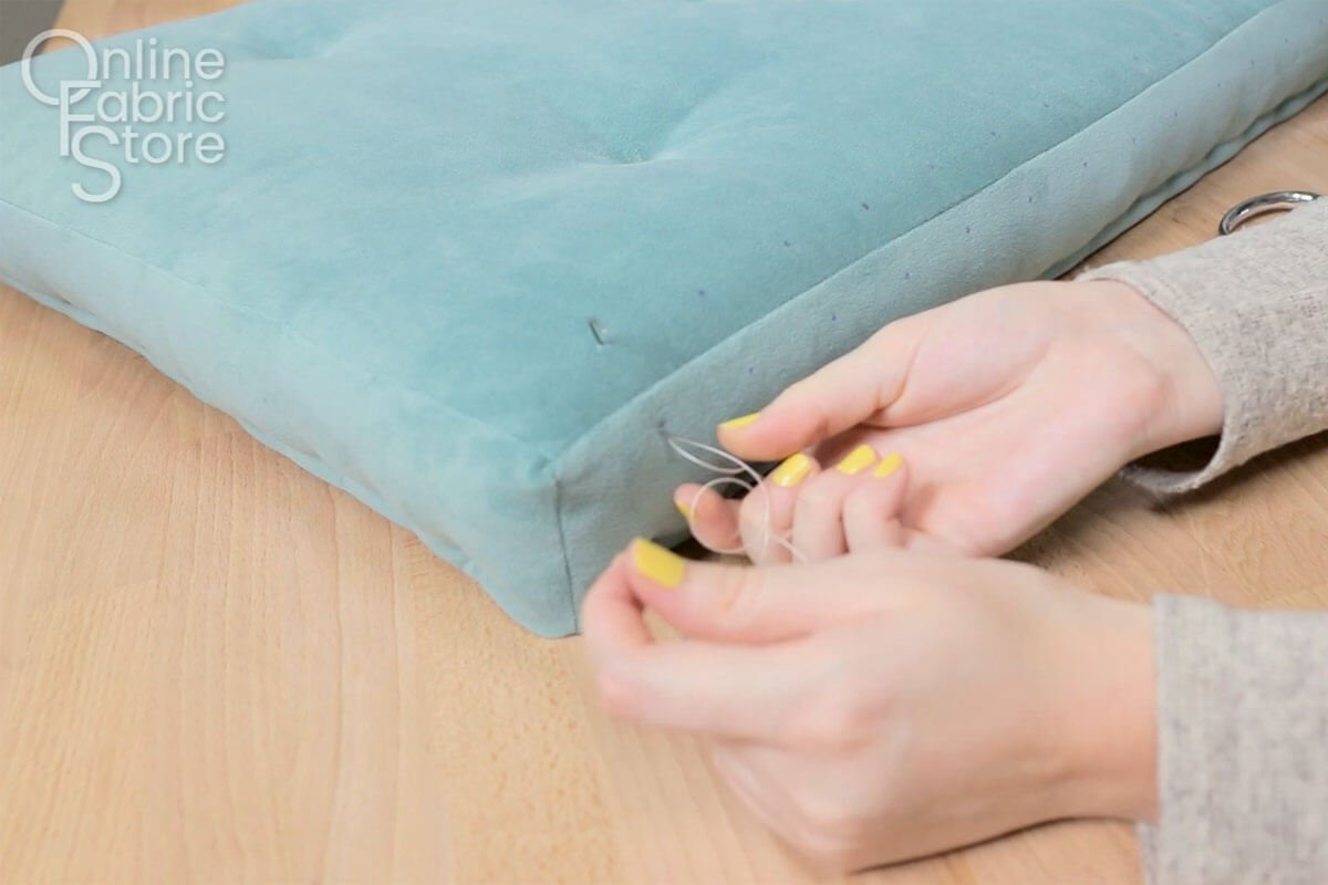 Bring Needle Up and Out the Top of the Cushion